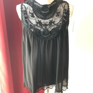 Beautifully embroidered and sheer neckline top